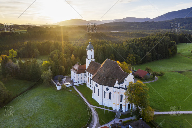 Germany- Bavaria- Upper Bavaria- Pfaffenwinkel- Wies- Aerial view of Pilgrimage Church of Wies to the Scourged Savior at sunrise