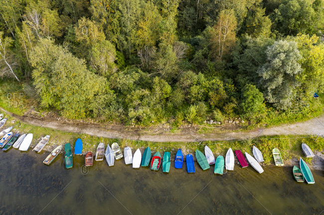 Germany- Bavaria- Row of boats left on shore of Gruntensee lake