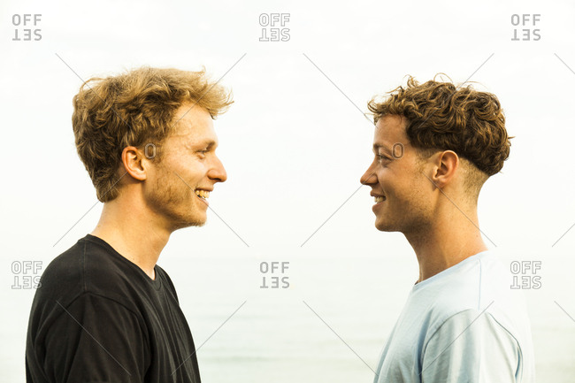 Portrait of strawberry blonde young men- face to face
