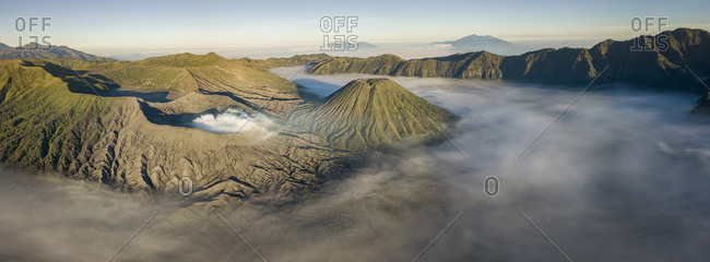 Indonesia- East Java- Aerial panorama of Mount Bromo shrouded in morning fog