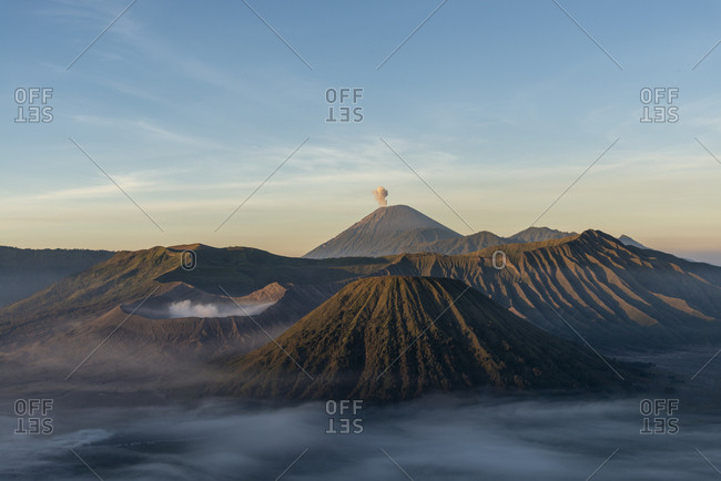Indonesia- East Java- Aerial view of Mount Bromo shrouded in morning fog