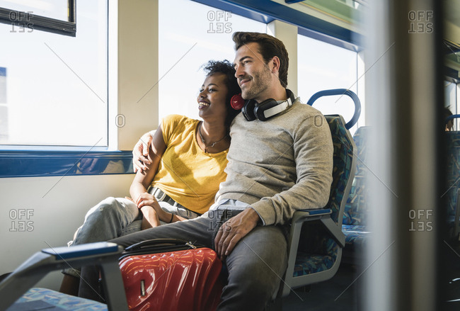 Young couple relaxing in a train