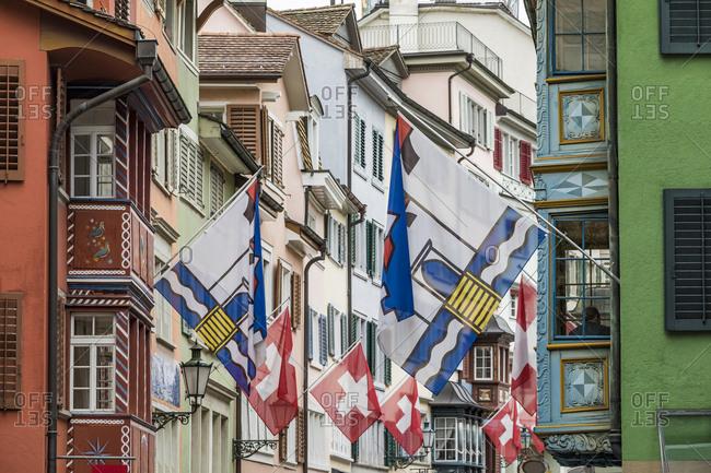 Switzerland- Canton of Zurich- Zurich- Flags hanging over Augustinergasse lane