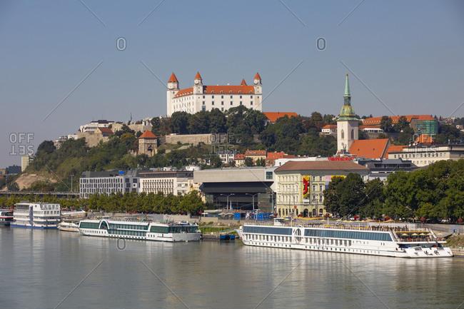 September 5, 2019: Slovakia- Bratislava- Cruise ships moored on Danube river and Bratislava Castle