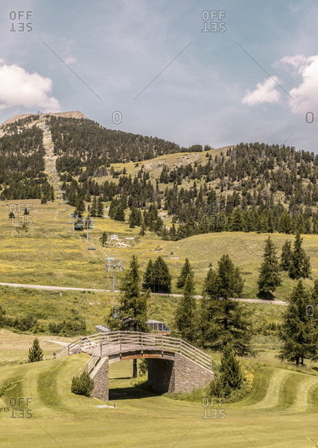 Montgenevre, France - July 18, 2019: Ski lift on golf course in the French Alps