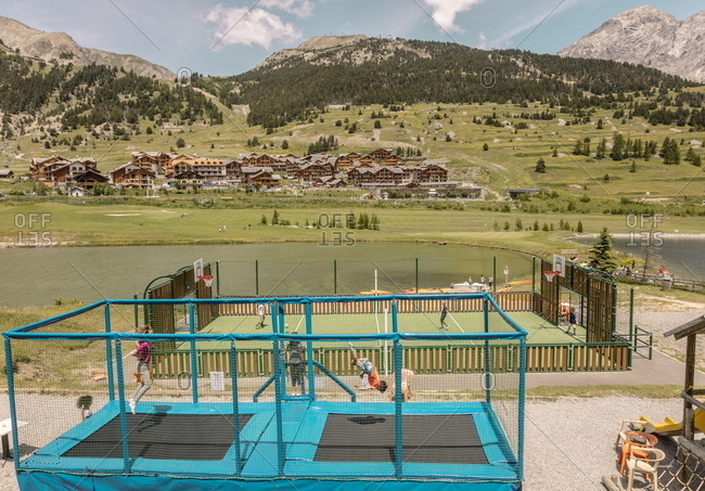 Montgenevre, France - July 18, 2019: Kids playing at recreation area of a resort in the French Alps