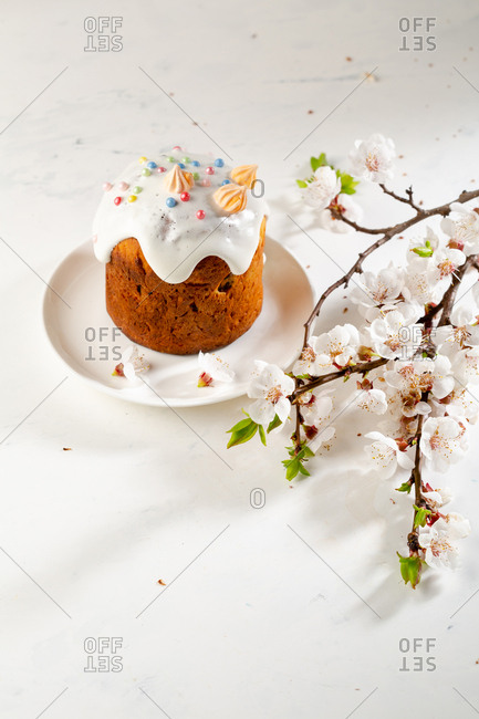 Traditional Easter Kulich bread with flower blossoms
