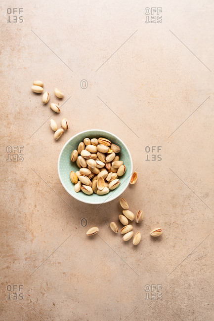 Pistachio nuts with shells in a bowl