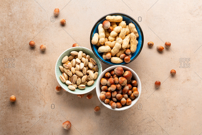 Overhead view of pistachio nuts, hazelnuts and peanuts