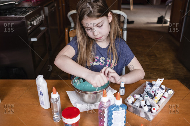 Young girl making slime