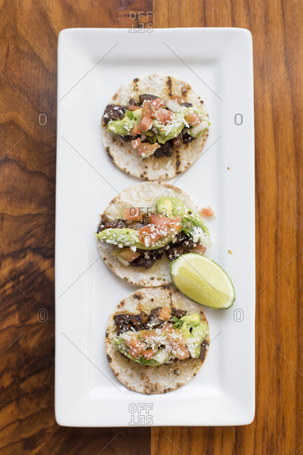 Overhead view of tostadas in plate at table