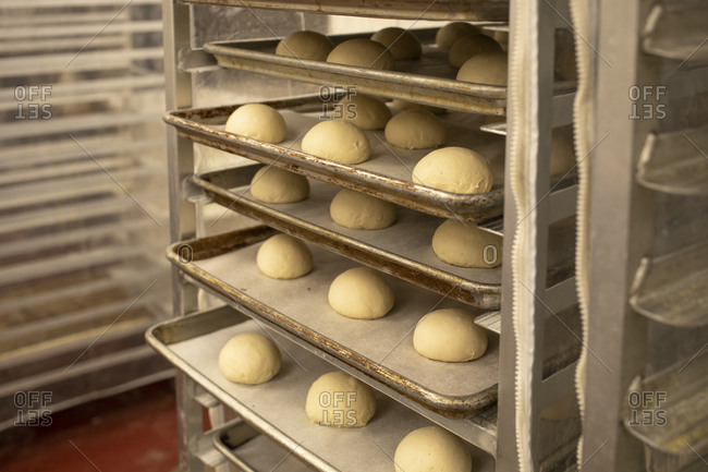 Handmade dough balls wait to be baked in the oven