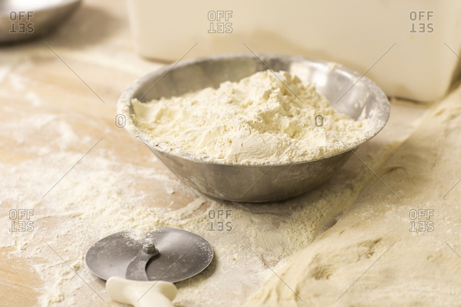 Flour used for making fresh bread sits in bowl
