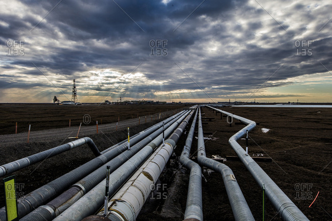 High angle view of Trans-Alaskan Pipeline against cloudy sky during sunset