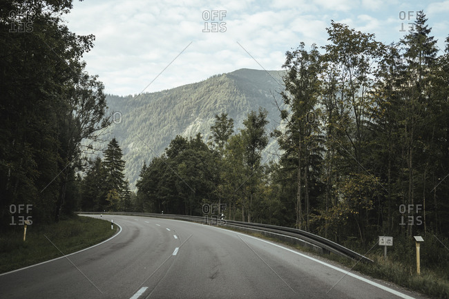 Diminishing perspective of empty road amidst trees against sky in forest