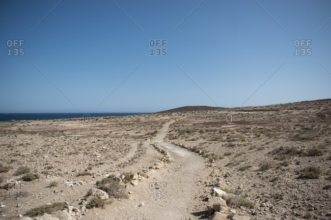 Desert unique landscape area with Atlantic Ocean and sky on background