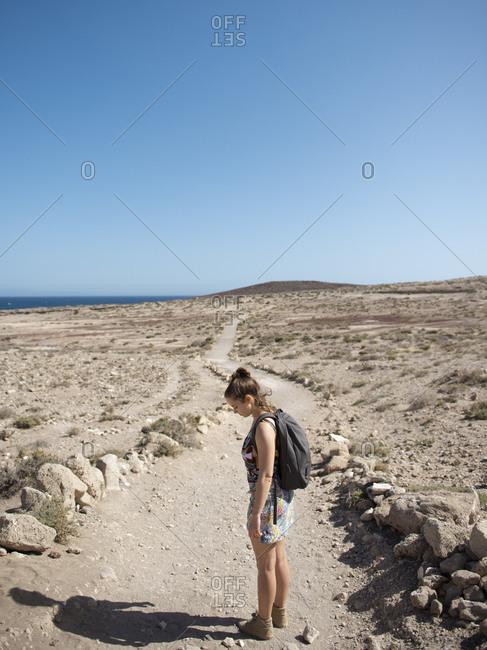Female traveler enjoying the walk in desert landscape area sunny day