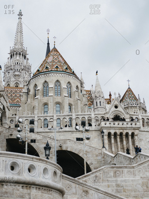 Low angle view of Fisherman's Bastion in Budapest against cloudy sky