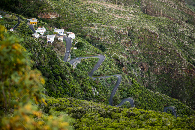 Scenic view from above of winding road through mountains in Tenerife