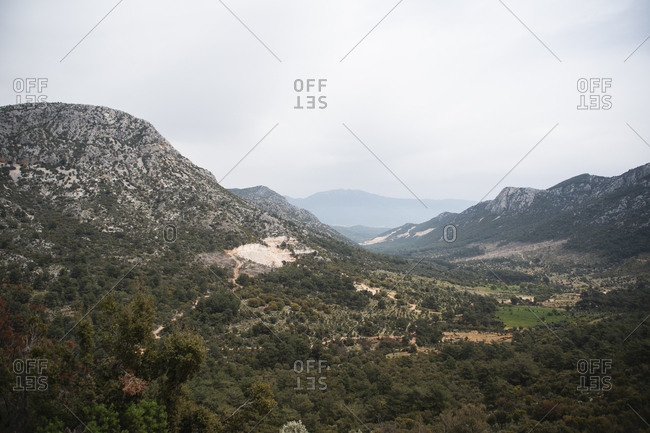Tranquil scenic panorama of mountain green valley against the sky