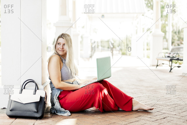 Creative woman working outside with a laptop