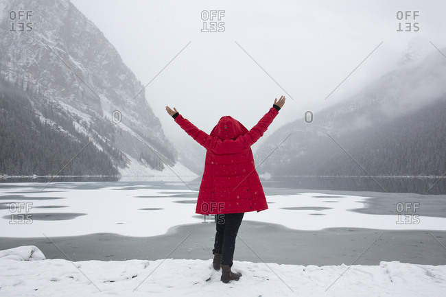 Chinese tourist excited by view of snowfall at Lake Louise, Banff National Park, Alberta, Canada