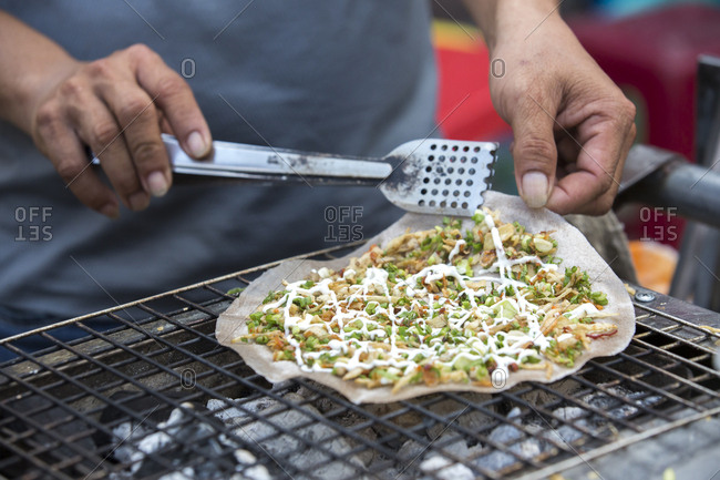 Close up of a seafood pancake made on the street in Hoi An, Vietnam.