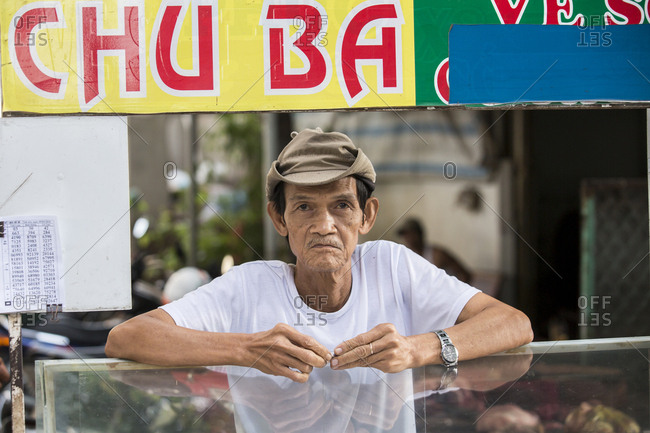 Mekong Delta, Vietnam - March 10, 2018: Portrait of Vietnamese man with hard face wearing hat.