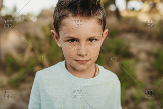 Serious portrait of kindergarten aged boy staring seriously
