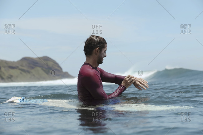 Smiling man on surfboard on the