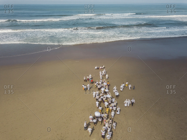 Aerial view of Balinese ceremony at the beach