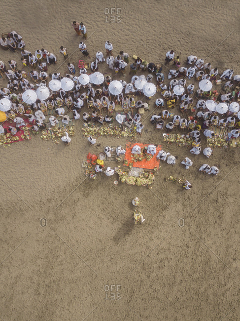 Indonesia, Bali - October 6, 2019: Aerial view of Balinese ceremony at the beach