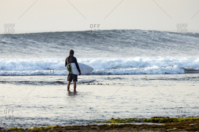 Surfer looking at wave