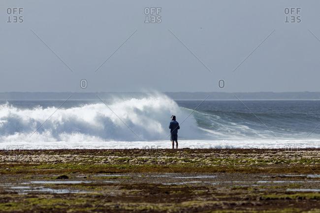 Man at ocean coastline - Offset
