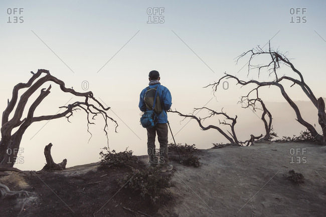 Young man looking at Ijen lake