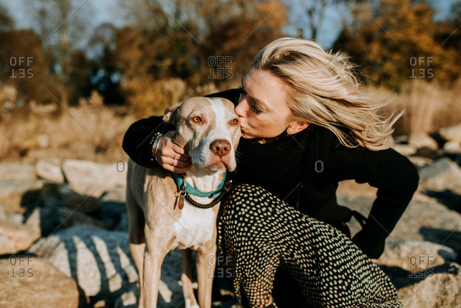 portrait of dog and woman in sunshine