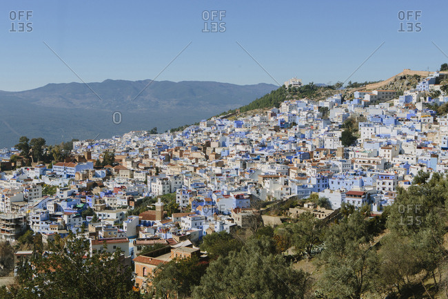High angle view of buildings on mountain against clear blue sky