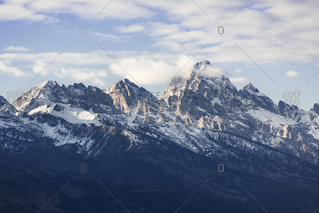 Scenic view of snowcapped mountain against cloudy sky at Grand Teton National Park