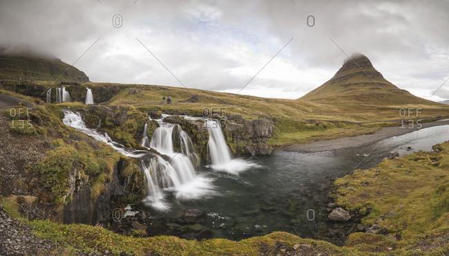 Kirkufell mountain in panoramic view with small waterfalls