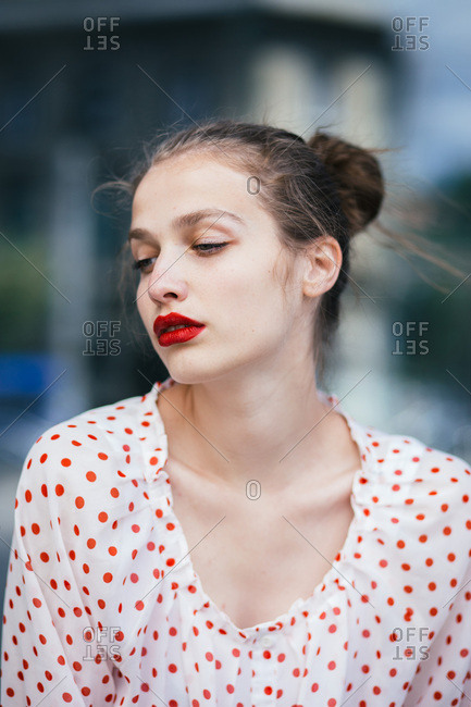 Close-up portrait of young woman wearing red lipstick