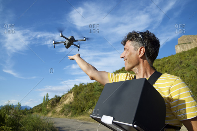 A man driving a drone in the Pyrenees.