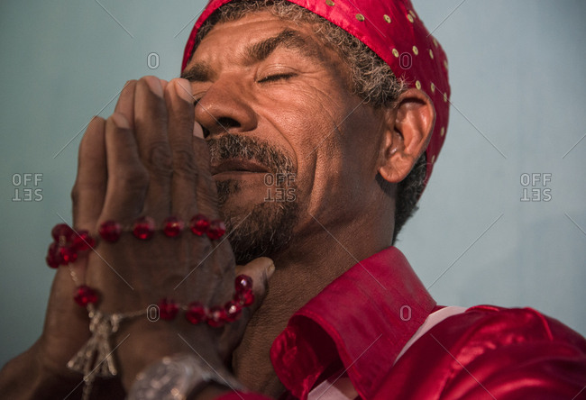 Brazil, Minas Gerais - March 19, 2016: Afro-Brazilian man praying during carnival religious party