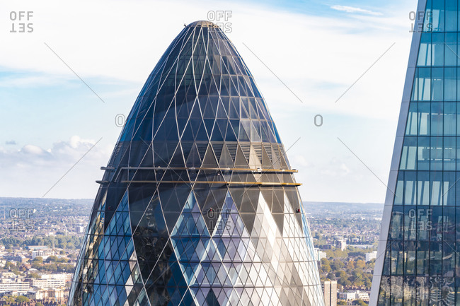 United Kingdom, England, London - September 28, 2018: Detail of the Gherkin tower exterior with blue sky