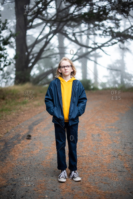 Tween boy outside on hiking trail full body