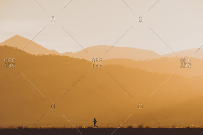Runner against a background of the layers of the rocky mountains