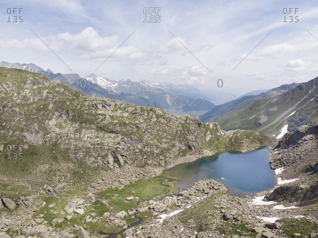 Aerial view of glacial lake and Swiss mountains