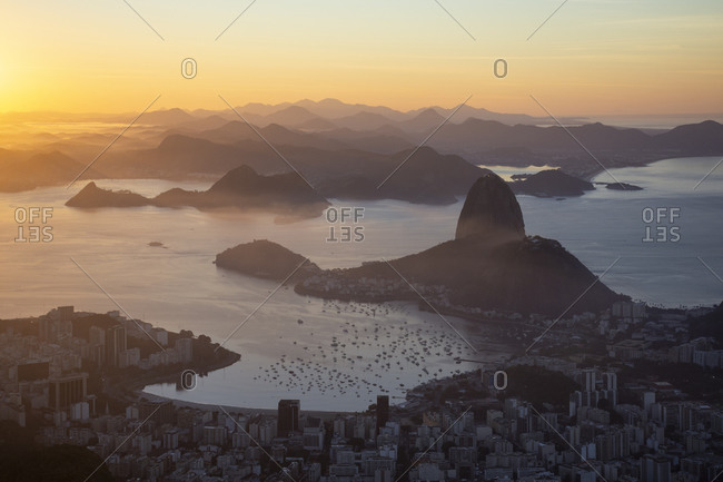Beautiful sunrise landscape of sugar loaf, ocean, city and mountains