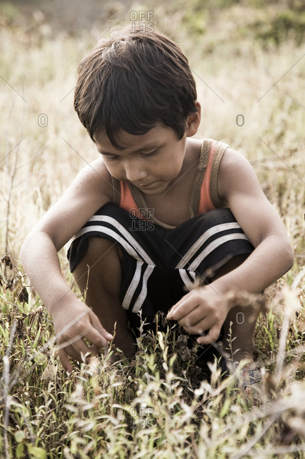 Mexico, Oaxaca - July 28, 2009: Farmer child playing in the field in Mexico