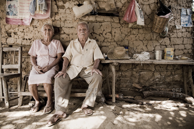 Mexico, Oaxaca - July 29, 2009: Portrait of an adorable couple of grandparents in their humble house in the countryside.