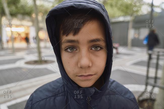 Green eyed boy portrait in the street